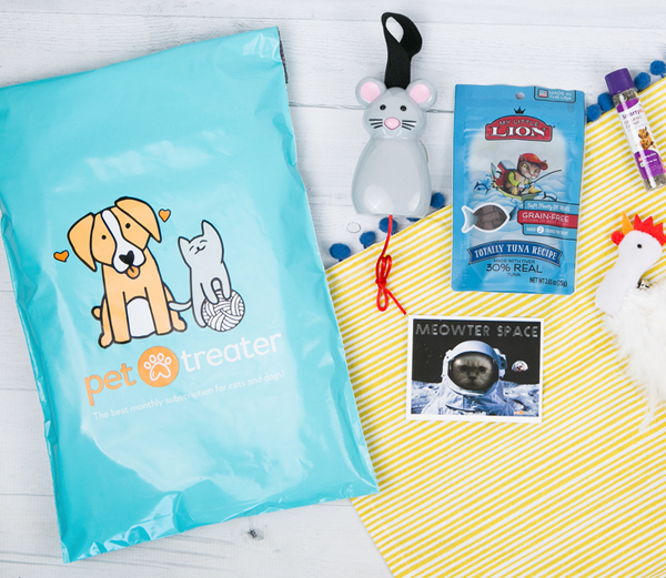 Pet Treater subscription mailer shown next to cat toys and treats.